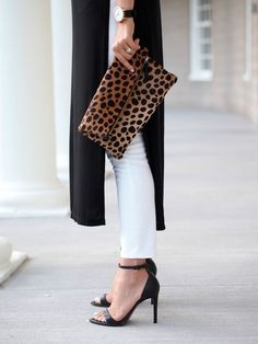 d7aa1838ff9 White jeans with minimalist black sandals and a leopard print clutch