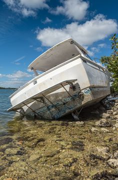 Boat damaged and abandoned by the passage of a cyclone in Miami. Boat are very expensive to own and there are too many variables that can impact the overall cost of insuring a boat. Read our guide to know the best boat insurance calculators on the internet. Including tips for boat insurance. Hurricane Damage, Buy A Boat, Boat Insurance, Boat Safety, Storm Surge, Best Boats, Fishing Charters, Out To Sea