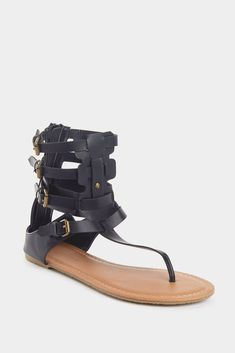 a3fb2e0cc8cc3f Give your shoe style a little upgrade with the boho inspired Jezebel Black  Gladiator Sandals. With a comfortable rubber sole and buckle straps