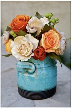 Love the color combination, the pottery design, and without a doubt, the flower arrangement.