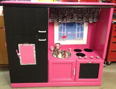 We made this play kitchen out of an old entertainment center. And when I say 'we' I mean Lance...but I did decorate it. Saw it originally on Pinterest. The girls love it!