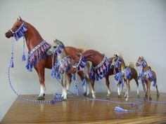 CM Breyer or Peter Stone Arabian costume halter presentation sets - ice blue base with royal blue and lavender accents in a variety of sizes on (left to right) Breyer Proud Arabian Mare, Proud Arabian Foal, Classic scale Sagr, Collecta Arabian, and Breyer Paddock Pals/Little Bit Arabian