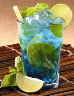 Blue Mojito: Shake 1 ounce of blue curacao liqueur with 2 ounces light rum & 6 or so mint leaves with ice in a cocktail shaker. Strain into a rocks glass & top with 3 ounces of club soda. Garnish with a few mint leaves & enjoy! Party Drinks, Cocktail Drinks, Alcoholic Drinks, Beverages, Cocktail Shaker, Cocktail Garnish, Blue Drinks, Mixed Drinks, Blue Cocktails