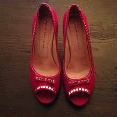 Red suede studded Marc Jacobs heels Red suede Marc By Marc Jacobs studded heel. Heel and platform lined with patent black leather. One or two studs missing but not noticeable. In good condition with some visible wear. Size 40 but fits a US 9. Marc by Marc Jacobs Shoes Heels