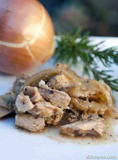 Slow Cooker Shredded Rosemary and Onion Pork Chops - This is dinner tonight and I'm loving that it's under 200 calories! #lowcalorierecipes #slowcookerrecipes