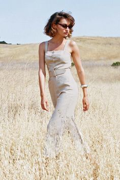 The soft but structured linen fabrication is a fresh take on our best selling Mango Jumpsuit. Features self-adjusting wide straps and a straight neckline for a clean look. The leg hits at the ankle and features front patch pockets along with a matching belt and buckle. An easy and effortless piece that will become a staple in your wardrobe.