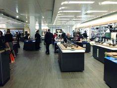 """Modern, sleek look in store with movable fixtures for easy layout alterations"" - from @lou_m_h at @Sherry S Dixon Retail"