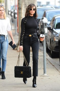 Olivia Culpo wearing Chanel Quilted Flap Xl Bag, Jean Atelier High Rise Flip Jeans in Lava, Are You Am I Selya Top, Saint Laurent Opyum Booties and Linda Farrow 427 C4 Oval Sunglasses in Dark Nickel
