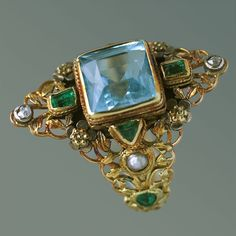 arthur and georgie gaskin.jewelry18k gold ring.3.5 aquamarine emeralds, diamonds and pearls emerald-like stones by moosoid9, via Flickr