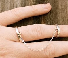 Two sterling silver hammered rings connected by a sterling silver chain - Linked Finger Cuff