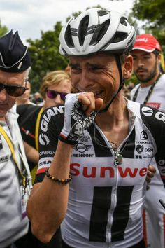 Secondplaced France's Warren Barguil cries after crossing the finish line at the end of the 1815 km ninth stage of the 104th edition of the Tour de...