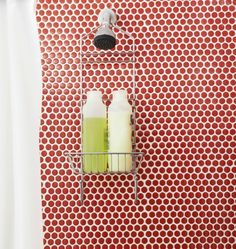 Our ModDotz porcelain #penny #round #tile makes a powder room fun in tv personality Katie Brown's Amagansett home. www.modwalls.com