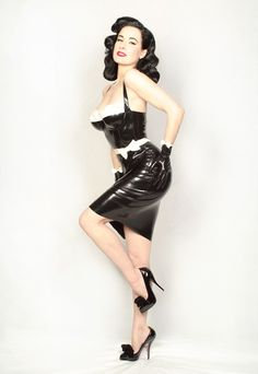 Pin-up dress is cute, but look at her HAIR!