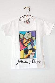Um! No! That is not the tattoo on that arm!!!!!!! If you are gonna make a shirt with Johnny Depp on it, get your facts right!!!
