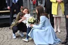 A young boy presented Kate with a bouquet and promptly burst into tears after being overcome by shyness as she visited a cycling themed festival in Place de Clairefontaine during a day of visits in Luxembourg Kate Middleton Dress, Kate Middleton Prince William, Prince William And Catherine, Kate Middleton Style, William Kate, Duchess Kate, Duke And Duchess, Duchess Of Cambridge, Bridesmaid Dresses