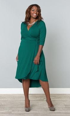 Feel ultra-feminine in our plus size Winona Wrap Dress.  This flirty and flattering wrap dress is on-trend with a hi-lo hem and a classic silhouette.  www.kiyonna.com  #KiyonnaPlusYou  #Plussize  #MadeintheUSA  #Kiyonna