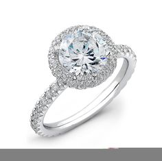 Ladies Platinum french pave diamond halo engagement ring 0.33 ctw with 7mm natural Round white sapphire