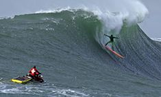 Surfers Ride Moving Mountains At Mavericks Big-Wave Surf Contest