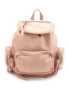 Mini Multi Pocket Backpack: Charlotte Russe. awesome for school chicks! want to look stylish while getting smart get one of these!