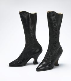 Boots: ca. 1896-1900, British, partially-painted leather padded with cotton fabric, leather, and silk satin, metal buttons, leather insole.