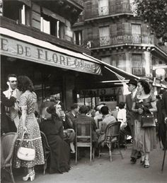 Cafe de Flore, Paris - 1949 - Photo by Robert Doisneau street fashion style vintage photo print ad women dress shoes purse 40s 50s