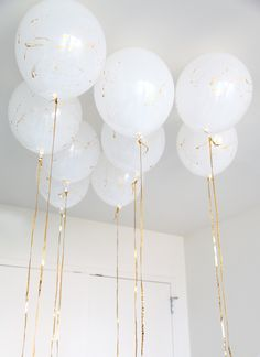 Gold string for white balloons