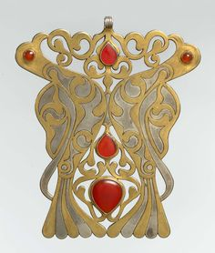 Central Asia or Iran. Pectoral Ornament  circa 20th century of silver, fire-gilded and chased, with openwork and table-cut and slightly domed and cabochon carnelians.