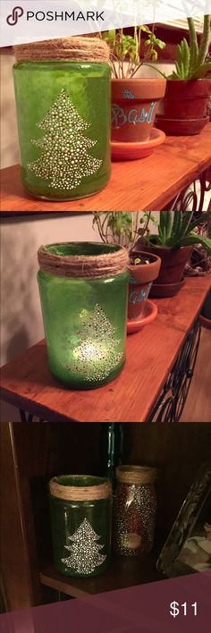 Christmas Tree Candle Holder Christmas is right around the corner, so of course that means it's time to decorate! This adorable candle holder has been made from recycled glass and is waiting to add Christmas cheer to your home! Handmade by a local Buffalo artist. Urban Outfitters Other