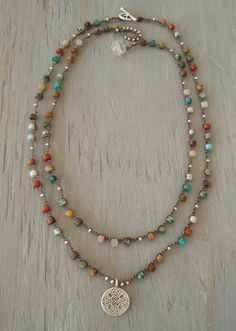 TWO necklaces to wear together, separate, 1 to give, 2 to keep for yourself :)...but really love the look of the two together!  Multi-colored and various rich, earthy toned semi precious stones-- agate, amazonite, jasper, turquoise, & quartz.... just to name a few :) A Thai silver pendant, generous in weight, gives this bohemian necklace a very free spirited, indie vibe. Thai silver has a higher silver content than sterling and is hand crafted for a very organic look. Ultimate boho-chic…