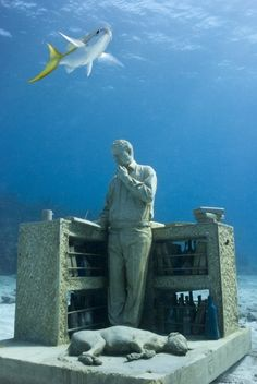 """All of Jason deCaires Taylor's undersea sculptures are beautiful and poignant, and The Dream Collector (""""El colecionista de los sueños"""") is my favorite of the collection, with its contemplative scribe and his own dog dreaming at his feet. Isla Mujeres, Mexico"""