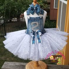 Looking for something fun and fashionable? Need to turn basic into blinged out fabulous? Step out in our denim & diamonds tutu jumper! Denim bib can be decorated with a letter, number, stars, butterfly, starburst, or scattered rhinestone design. Tutu portion can be made with standard