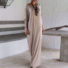 Light taupe maxi dress Super chic. Stretchable. One size NWOT. Asymentrical design. Can be wear off shoulder. Bust: 40 inches, waist: 40 inches, length: 59 inches. Color: black . NWOT. One Side Bottom split Other