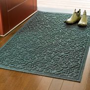 """These """"water glutton"""" mats will hold up to 1-1/2 gallons of liquid per square yard! With waterproof rubber backing and """"water dam"""" edge. Just vacuum clean when dry."""