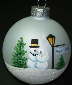4 inch Frosted Glass Ornament. Hand painted with a couple all decked out to be married. The Bride has a veil and gold necklace. The Groom has a