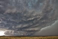 Tornadic supercell thunderstorm over a plain in Mycroft, Wyoming, US.  Supercell thunderstorms rotate with immense energy, causing a strong updraft and severe weather, including tornadoes, hail, heavy rain, lightning and heavy winds. Inside these severe long-lived storms the wind speed and direction changes with height. This produces a strong rotating updraft of warm air (a mesocyclone) as well as a separate downdraft of cold air. Around a third of supercells produce tornadoes and are termed tor