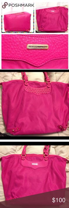 💕Rebecca Minkoff Tote!💕will fill with gifts!😘💋 Nylon tote is studded with leather trim. The slip top opens to a lined interior with one pocket. Rolled double handles. Snaps on side to change shape of tote. Height 12 inches, length 13 inches, depth 7 inches. Will fill with free gifts such as make up, Jewlery, nail polish and fun stuff!😘💕 Rebecca Minkoff Bags