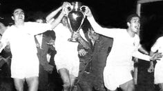 Real Madrid parade the trophy after prevailing 4-3 against Reims in the first European Cup final