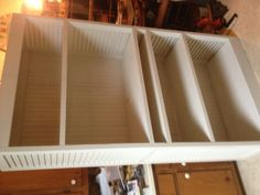 Bookcase/Entertainment center- Built out of two old shutters and some scrap shelving boards and 1x4's . Used in my master bedroom along with my old door Headboard. Pinned by builder on his DIY board.-by Lanier Owen