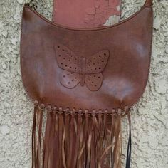 "Trendy Butterfly Fringe Shoulder Bag Super cute butterfly fringe shoulder bag - approximately 12"" across and 6"" high, leather look. The bag is smaller, can hold a phone, wallet and lipstick and is man made materials. Fun casual bag for summer! Bags Shoulder Bags"