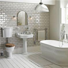 badeeinrichtung mit weißen bademöbeln und grauen fliesen - 77 Badezimmer-Ideen für jeden Geschmack