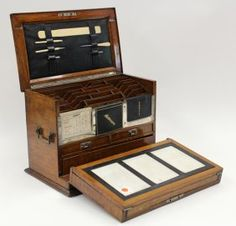 Gentelmans travelling lap desk circa 1890, executed in quartersawn oak, the hinged and folding case having a fitted stationary compartment, drawers, writing implement, unused address book, 1896 calender, embossed leather writing surface, and a small flask in the hidden compartment