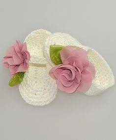 This Ivory & Pink Rosette Crochet Booties by Pink and Blue Knitwear is perfect! #zulilyfinds