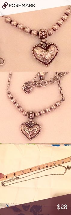 """💕Brighton Silver Heart Necklace w/ 2"""" extender💕 This is so lovely. On one side of the heart there is a solitary CZ inlay.  On the other side of the heart, are silver etchings typical of Brighton's signature style. It is reversible and adjustable. Gently used. NO TRADES OR OFF POSH TRANSACTIONS. Thanks. 😊 Brighton Jewelry Necklaces"""