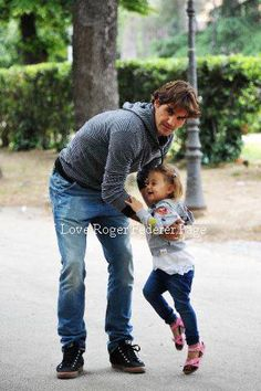 Roger Federer with one of the twins...so cute