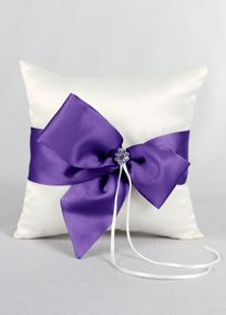 "David's Bridal Exclusive ring bearer pillow featuring a bold satin modern bow topped with a rhinestone brooch that is wrapped around this pillow to create a sophisticated and luxurious look.  Features and facts:  Measures 8"" square.  Accent ribbon is available in David's Bridal exclusive colors!"