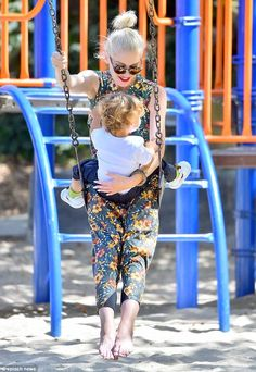 Here we go! Gwen prepared to kick off as she played on the swings with her son