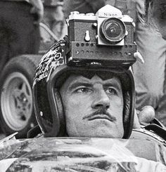 Before GoPro, there was....  Formula One double world champion Graham Hill ready to take some high speed pics!