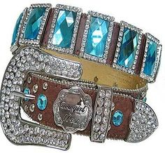 If you are going to wear o cowboy belt... Make sure that it has some bling on it... especially colored stones and rhinestones...