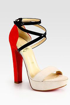 Christian Louboutin Suede and Leather Criss-Cross Colorblock Sandals, $995, available at Saks Fifth Avenue.