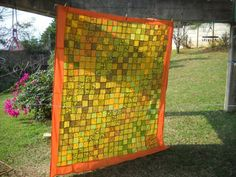 Sunny yellow patchwork curtain airing outdoors
